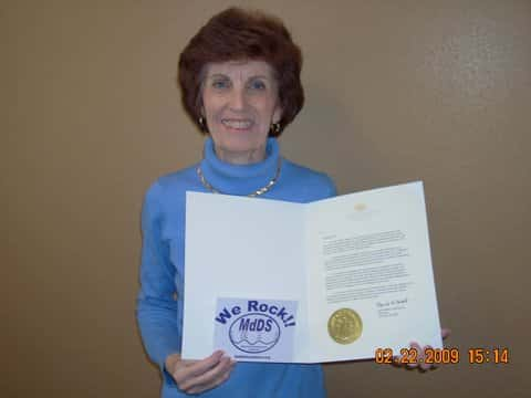 Marilyn holding her Rare Disease Day Proclamation